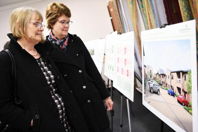 Wendy Best and Sara Frost look at the drawings for the Workhouse site in Hexham. Photo: HX111924. KATE BUCKINGHAM.