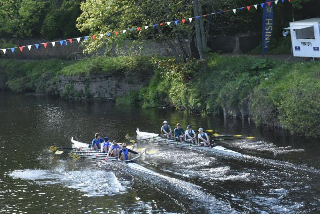 Hexham (in blue) clash with Doncaster on the finish line of the open men's race.