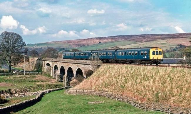 A Haltwhistle-bound diesel train at Burnstones, Slaggyford, in the last weeks of operation of the South Tynedale Railway in April, 1976. The line ran from Alston to Haltwhistle. The section from Alston to Slaggyford has since reopened as a heritage narrow