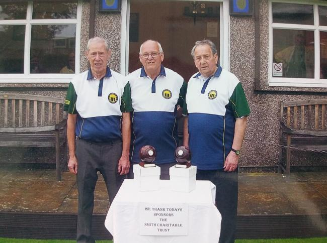 Haltwhistle secretary Maurice Davidson presents the trophies to winning pair Malcolm Davidson and Michael Rogan.
