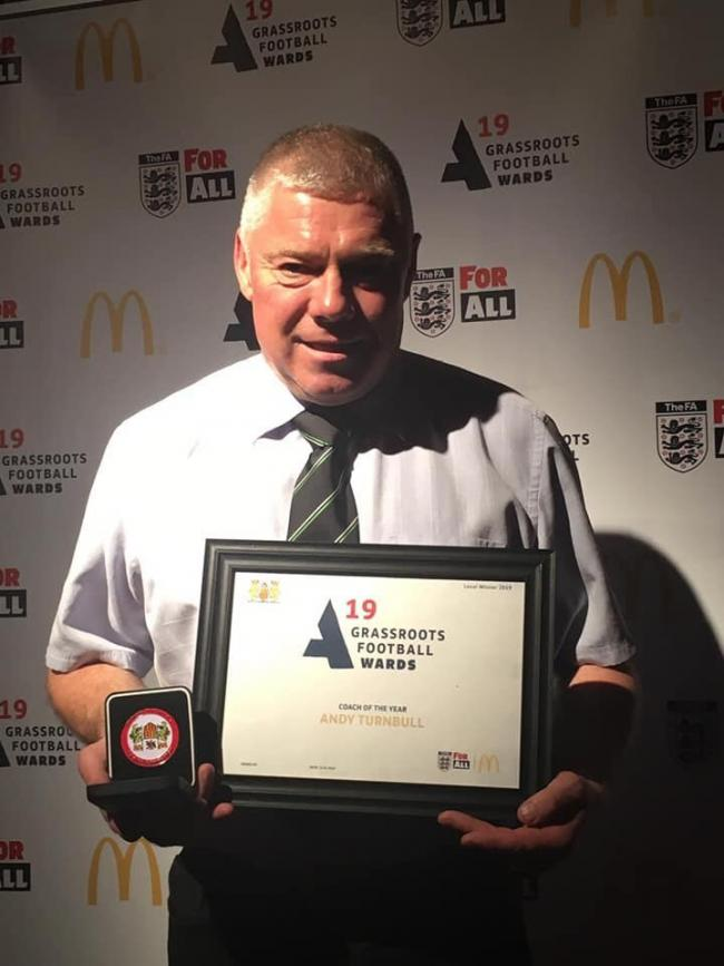 Hexham football coach Andy Turnbull with his award.