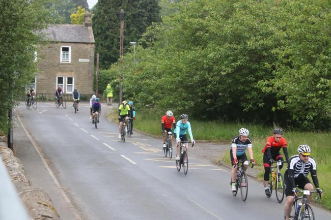 A group of cyclists depart Haydon Bridge via Station Road at the start of last year's Haydon Hundred.                                 Photo: IAN HEARDER